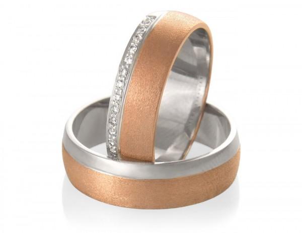 Poročna prstana iz belega, kromiranega in rdečega zlata.